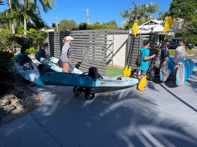 noosa resorts for families - family hiring kayak from Noosa Place